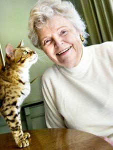 Claremont resident Jean Mill plays with Lisa Love, one of her champion Millwood Bengal cats. Ms. Mill has been breeding Bengals for 25 years. Her unique breed is recognized by cat enthusiasts around the world.
